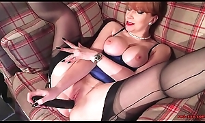 Sultry Grown up Redhead relating to Lingerie Fingers Her Cunt