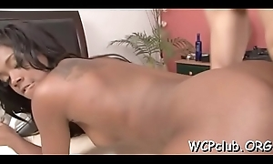 Big boob white tantalize is having interracial sex with darkling baffle